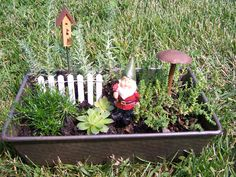 Little gnome/fairy garden in a loaf pan - sweet!