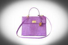 Lizard purple handbag