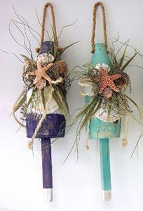Authentic wooden lobster buoy with seashells and sea grass.