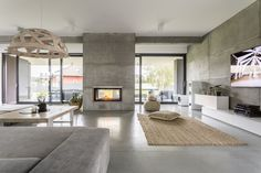 What Are The Characteristics Of Modern House Design? - Preferred Homes What are the characteristics of modern house design? - Preferred Homes modernist house design - Modernist House European House, Fireplace Design, Tv Fireplace, Fireplace Furniture, Custom Fireplace, Concrete Fireplace, Mid Century House, Minimalist Home, Modern House Design
