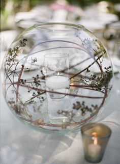 Fish bowl, swirled floral or branches (we can swirl orchids, callas, etc.), floating candle in the center. Can do a variety of heights, multiple candles in the center, etc.