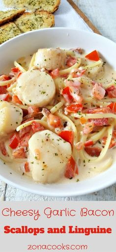 Cheesy Garlic Bacon Scallops and Linguine has pan seared golden brown sea scallops tossed together with a creamy Parmesan cheese sauce, tomatoes, garlic, and perfectly cooked linguine. This recipe is easy and quick, ready in just 30 minutes. This dish makes a great romantic dinner for Valentine's Day or an impressive date night with your special someone.