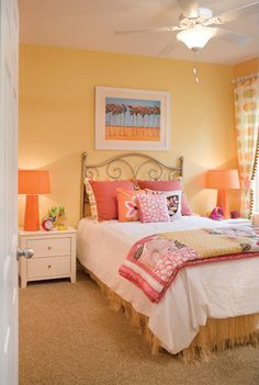 Great kids bedroom in The Surfside in Tampa, Florida. Love the muted yellow walls with hints of pink and orange throughout the textiles.