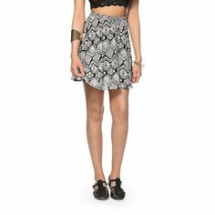 Made with a lightweight material with a gauze-like texture and feel for comfort, this skater skirt is in a tribal print design for a trendy look.