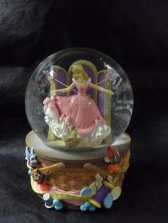 "DISNEY CINDERELLA ENESCO SNOW GLOBE ""A DREAM IS A WISH YOUR HEART MAKES"" found a goodwill for under 5 dollars"