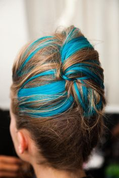 blue strands in a french twist