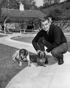 Clark Gable at home with his German Shorthaired pointer and dachshund