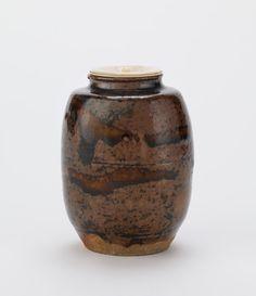 Seto ware tea caddy, katatsuki type  mid 17th century      Edo period     Stoneware with iron and ash glazes; ivory lid  H: 8.4 W: 6.4 cm   Seto, Japan