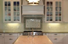 A brushed nickel sink would look fabulous in this kitchen - don't you think??