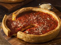 Godfather's Chicago-Style Deep-Dish Pizza Recipe Main Dishes with active dry yeast, warm water, sugar, salt, flour, yellow cornmeal, olive oil, shredded mozzarella cheese, italian sausage, diced tomatoes, dried basil, dried oregano, grated parmesan cheese
