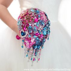 Wedding Dress Bouquet Brooch Bouquet Turquoise Bouquet Hot Pink Bouquet Bridal Bouquet Gold Silver Bouquet Crystals Bouquet Keepsake Bouquet ____________________________________________________ This glamorous, modern and bright brooch bouquet made in turquoise and hot pink colors, fully decorated jewels - brooches and crystals. This brooch bouquet is symbolizes two elements: water and air, and also is not only symbol of luxury and rich, but and freshness easy and clean. All of this colors…