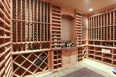 Craftsman Wine Cellar with Carpet, Crown molding, simple marble floors