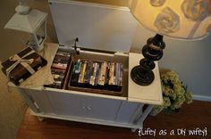 how to use a repurposed record player as a useful storage cabinet in your living room to hold movies or dvds etc. a