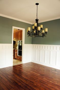 Two tone dining room with chair rail light color above for Light green dining room