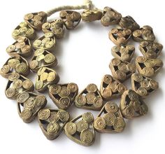 A strand of handmade Baule brass trade beads [BRT-60021] $22.00  Click to enlarge  This is a strand of authentic West African lost wax Brass Trade beads. These beads were handmade from the Lost Wax technique in the Ivory Coast of West Africa. 100% hand made. The condition is excellent.  Size : 25mm  Hole Size: 4mm  Length of the strand: 24inches Long  Approx # of beads 26 Beads