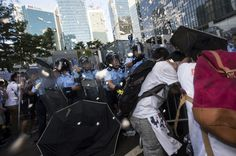Riot police target pro-democracy students with pepper spray after hundreds of protesters stormed into a restricted area at the government headquarters, after a rally ahead of the October 1 'Occupy Central' civil disobedience movement in Hong Kong September 27, 2014.