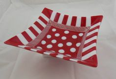 Fun, Funky, and Functional Fused Glass bowl with Red and White Stripes and Polka Dot Center. This bowl is approximately 11 square with flared corners