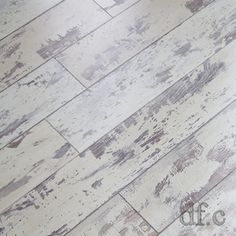 Love this! It looks like old, chippy painted flooring, but it's tongue & groove laminate flooring. It's easy to install and wouldn't show dirt like solid colored flooring. This would add so much character to a room!