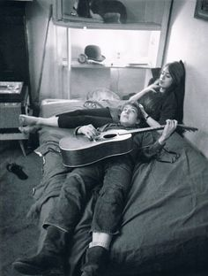 This photo has a lot of grain, a feeling of intimacy, and Bob Dylan. Cool photo in anyone's book. Bob Dylan and Suze Rotolo at their Greenwich Village apartment, January 1962