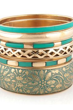 teal bangles. turquoise and gold so pretty together.