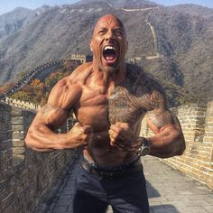 Dwayne 'The Rock' Johnson displays his bulging biceps and ripped six-pack as he poses for a shirtless snap on the Great Wall of China. Dwayne Johnson has proven once again why he is called The Rock, after posing for a shirtless picture on the Great Wall of China The 43-year-old actor showed off him impressive upper-body on the landmark near the capital of Beijing, where he is currently promoting his new film San Andreas, in the Instagram snap. The actor took the opportunity to educate his…