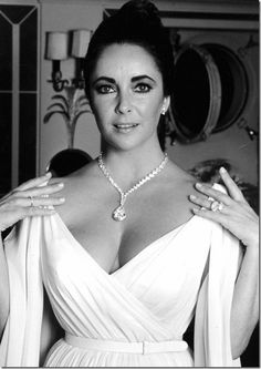 Just a few of her famous diamonds.  The diamond necklace was sold in 1978 to fund a hospital in Africa.  She is wearing the diamond ring (from Richard Burton), which it is said, she wore every single day.