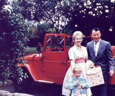 Roy Rogers and Dale Evans with their friend Marill Morgan, 1963. Marill Morgan is the niece of Jim and Celia Woodman. The photograph was taken in front of Roy Rogers' and Dale Evans' jeep at their home in Chatsworth. Chatsworth Historical Society. San Fernando Valley History Digital Library.