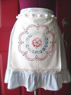 I love aprons and the sense of accomplishment at day's end when you take them off.  This one is too pretty to wear to clean house though.