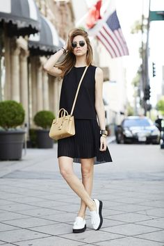 20 Ways to Pull Off Platforms This Spring - a flirty pleated mini skirt worn with a sleeveless black top + platform brogues and a structured, nude crossbody bag
