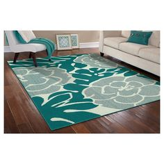 Style and value are what you get with this Valencia area rug from Garland Rug. Made in the USA and designed specifically for someone seeking value and style. The fun floral design on this rug will be the perfect accent for any room. Great for that first apartment, college dorm room, living room, home office, or any room needing a classic update. Valencia is machine tufted low pile level loop in Olefin yarn on traditional action back backing. Action back may require the use of a rug pad or…
