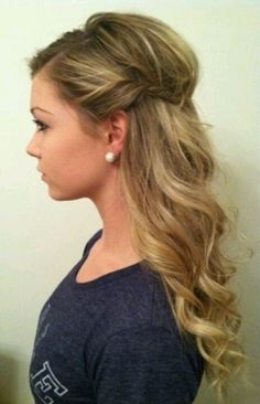Cute bouffant with curls. I think I'd do the half-updo with braids instead of twists though.