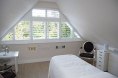Triangular shaped window which would be difficult to dress with curtains or blinds.