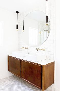 white penny round tile flooring round mirror subway tile backsplash