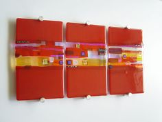 fused glass, multi colored with strips, dicro & reactive glass. Endless possibilities. Art by Kim Bramley red-triptych