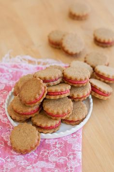Gingerbread-Raspberry Sandwich Cookies combine two distinct, delicious flavors: spicy gingerbread cookies and tart raspberry filling.