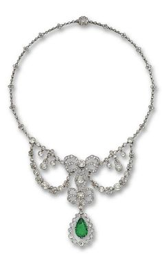 EMERALD  DIAMOND NECKLACE, CARTIER, PARIS, 1905. The floral garlands joined to a central motif of two ribbon bows supporting a swing pendant set with a pear-shaped emerald. continuing at each side to a floral chain, the whole millegrain set with old-mine, old European-cut  rose-cut diamonds, mounted in platinum, length 16½ inches, unsigned, side garlands detachable