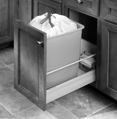 "No. 8: 18"" wide trash roll-out base cabinet (door front may be reduced to 15"" to clear corner; two trash cans on interior; single, centered cabinet pull -- WOULD BE IDEAL TO HAVE A DRAWER AT THE TOP TO HOLD TRASH BAGS, TRASH TICKETS, RECYCLING CALENDAR, ETC."