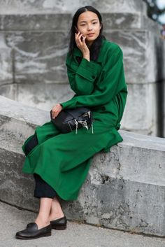 street-style-fashion-week-ss-2013-bright-green-huntergreen-trench-style-jacket-coat-model-style-leather-textured-bag-loafers-cuffed-pants-via-the-locals-dk