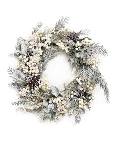 A snowy accent to your holiday décor, this wreath's festive charm lends your home glittering appeal year after year.