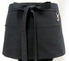 "The black waitress apron measures 27 X 11.5"" with 45"" ties. The apron is made with Robert Kaufman organic kona cotton. The pockets and back are fully lined with a black twill cotton. The half apron also has a zippered pocket and key clasp for safe keeping your valuables. This is a perfect workhorse apron for waitresses, bartenders, craft show vendors, or just because you love black!!"