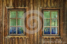 Photo about Blue color vintage bottles sitting on wooden window. Image of wooden, ancient, farm - 69478769 Wooden Windows, Photo Blue, Vintage Bottles, Architecture Details, Stock Photos, Image, Painting, Color, Art