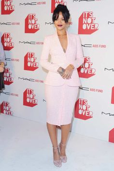 Rihanna took the MAC Cosmetics premiere of It's Not Over as an opportunity to show off her best attempt at business casual. For this office-inspired outfit, she donned a quaint pink-gingham skirt suit from Altuzarra's spring 2015 collection, which she paired with a chic chignon and plum lipstick — pulling together a prim-and-proper look with enough edge to ensure that her sternum was still visible.