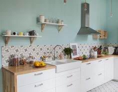 Graphic tiles and a pastel accent wall in a stunning contemporary kitchen.