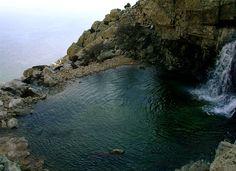 Waterfalls of Ryakas and the lake Selini at Ikaria island Aegean sea