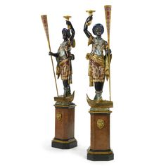 A pair of Venetian polychrome-painted and parcel-gilt blackamoor torchères on pedestals, last quarter 19th century.