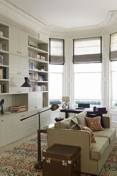 Discover living room design ideas on HOUSE - design, food and travel by House & Garden. The bespoke shelving unit is the star of the show in...