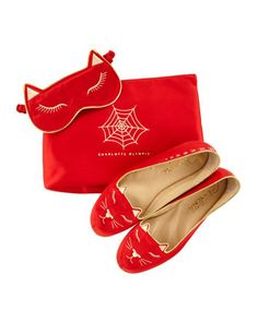 THE CONSTANT TRAVELER - Charlotte Olympia's satin kitty slippers & eye mask kit.
