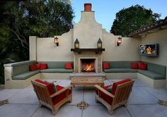 This patio is equipped with loads of seating options. Maximizing the patio space is important, especially if yours is a gathering place like this one. Design by Matthew Mckilligon Design. Outdoor Walls, Outdoor Rooms, Outdoor Living, Outdoor Decor, Outdoor Kitchens, Outdoor Cooking, Outdoor Fireplace Designs, Backyard Fireplace, Outdoor Fireplaces