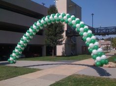 Balloon Arch. Green and White Balloons.