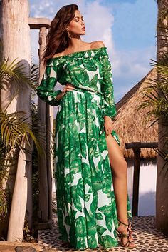 Wear this unforgettable palm print maxi dress on your next exotic getaway. It's designed with a smocked off-the-shoulder neckline, long sleeves with elastic cuffs, an effortle